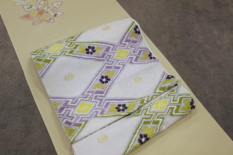 洛風林の菊華菱格子文の袋帯